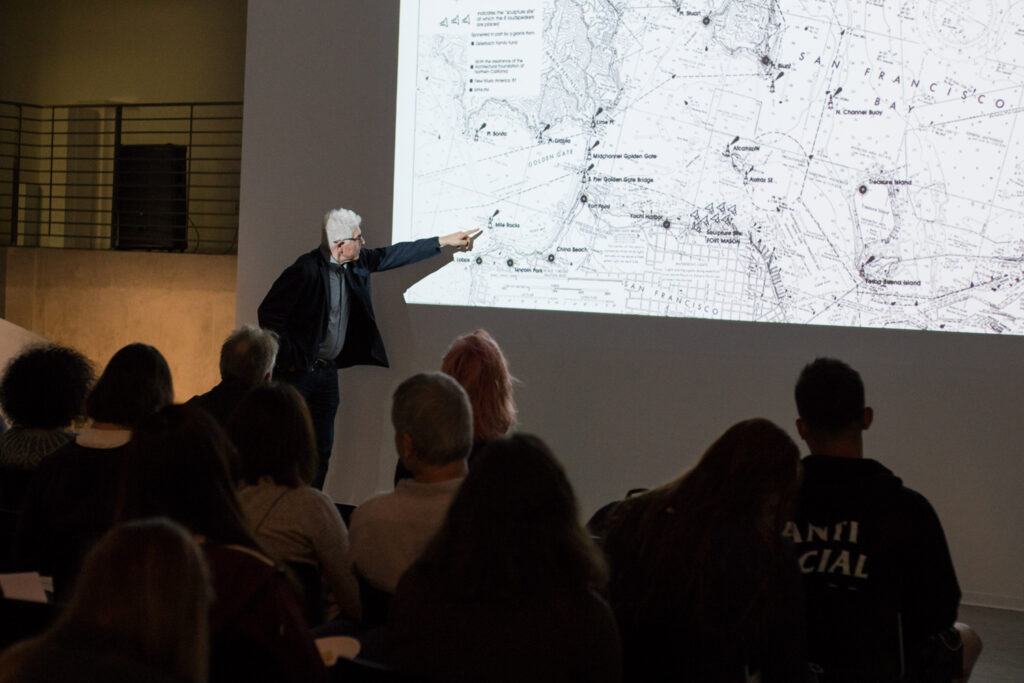 Bill Fontana pointing to a map of San Francisco.