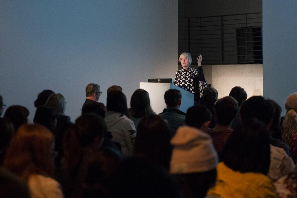 Helen Molesworth showing a slide during her presentation in the EDA pit.