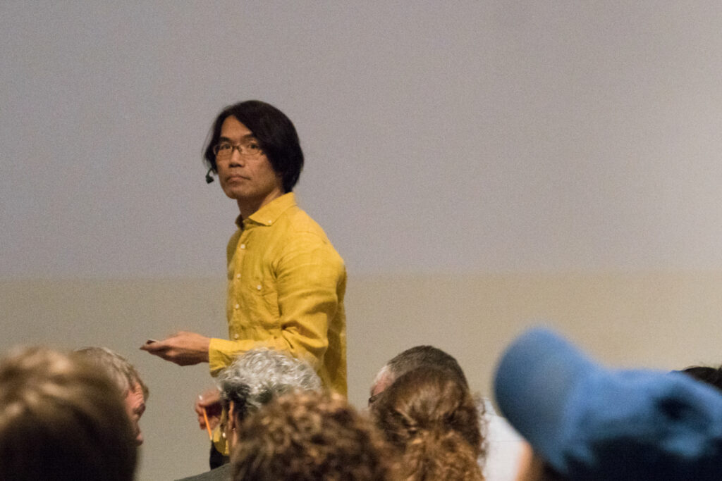 Toshio Iwai is staring at the audience.