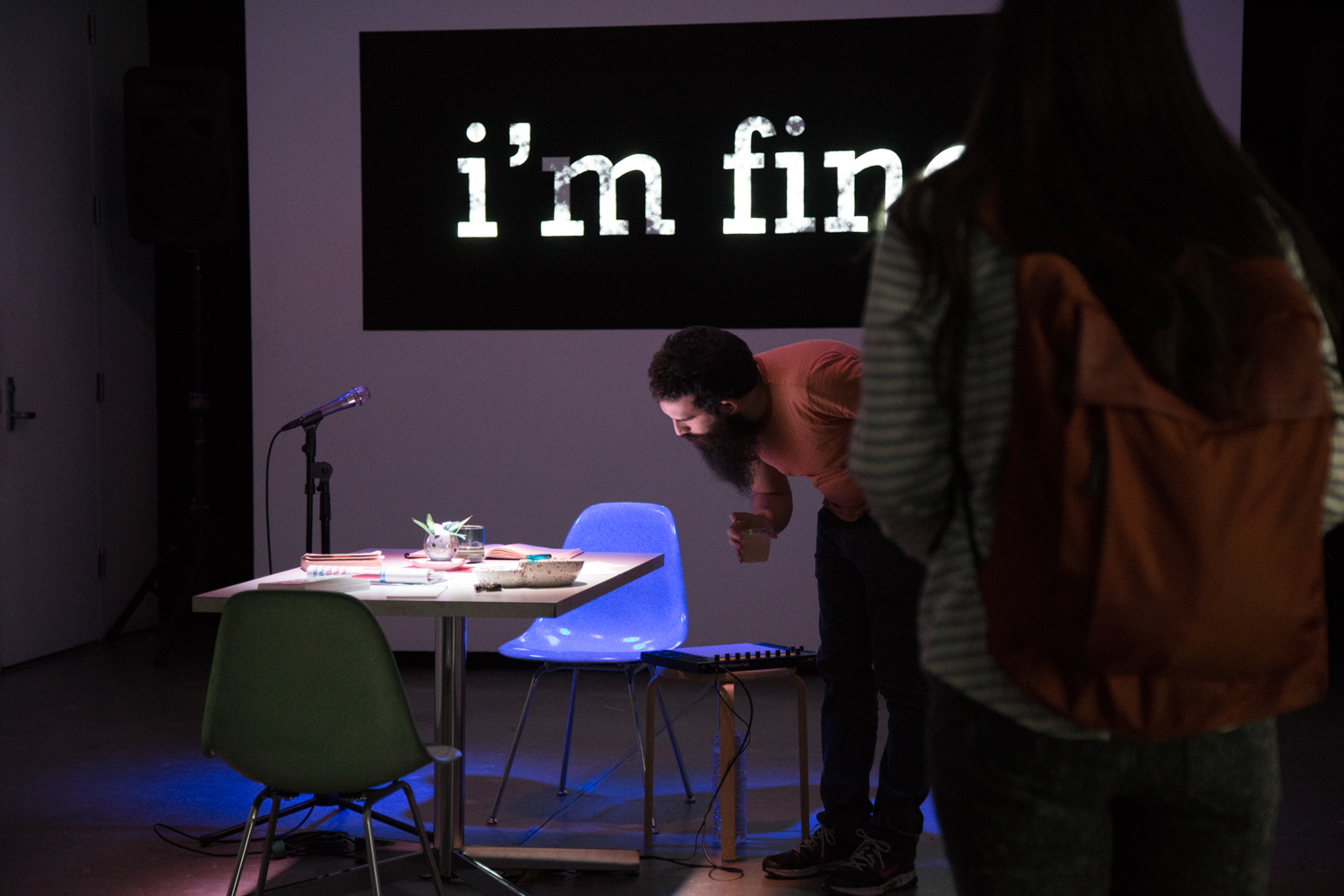 """The words """"I'm fine"""" is being projected on a wall."""