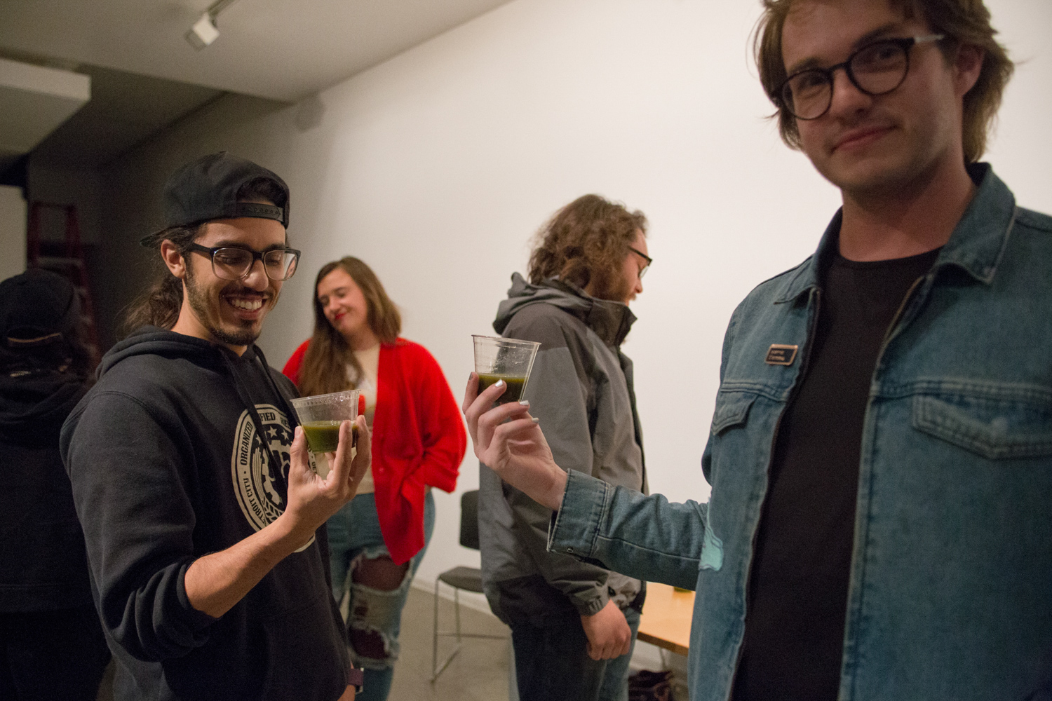 People giving each other a toast at Paul Esposito's solo show.