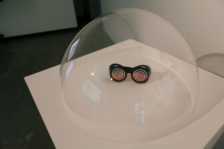 Googles sitting inside an acrylic dome.