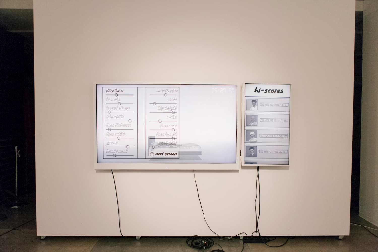 TV screens of character customization setup. The TV screens have white bezels.