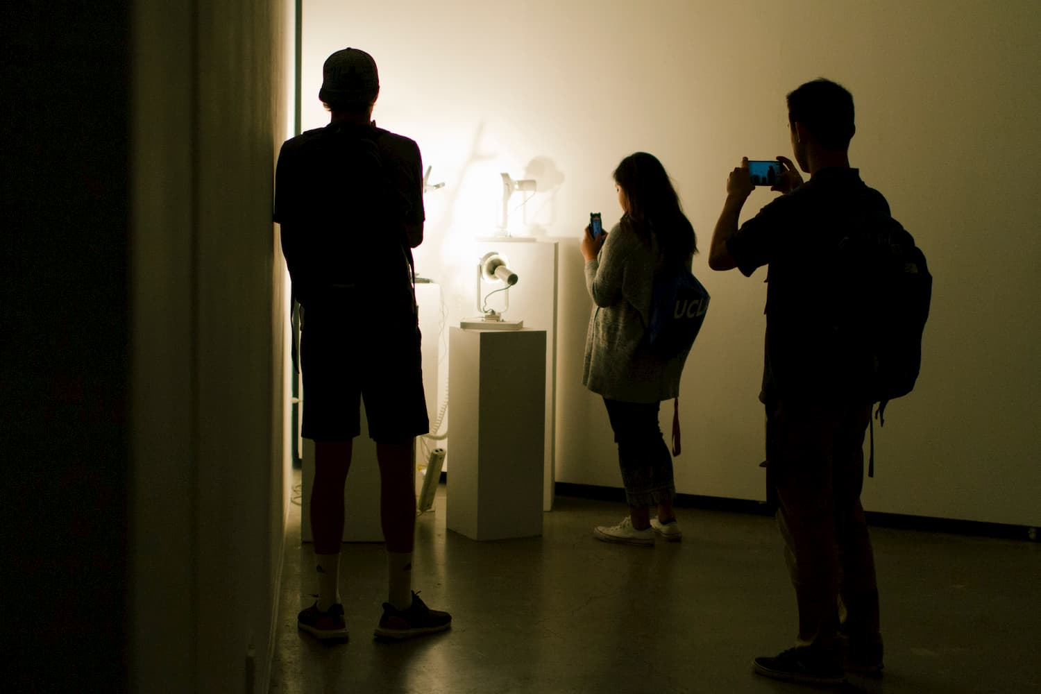 Series of lamps aimed toward a wall during YOUJIN CHUNG's solo show.