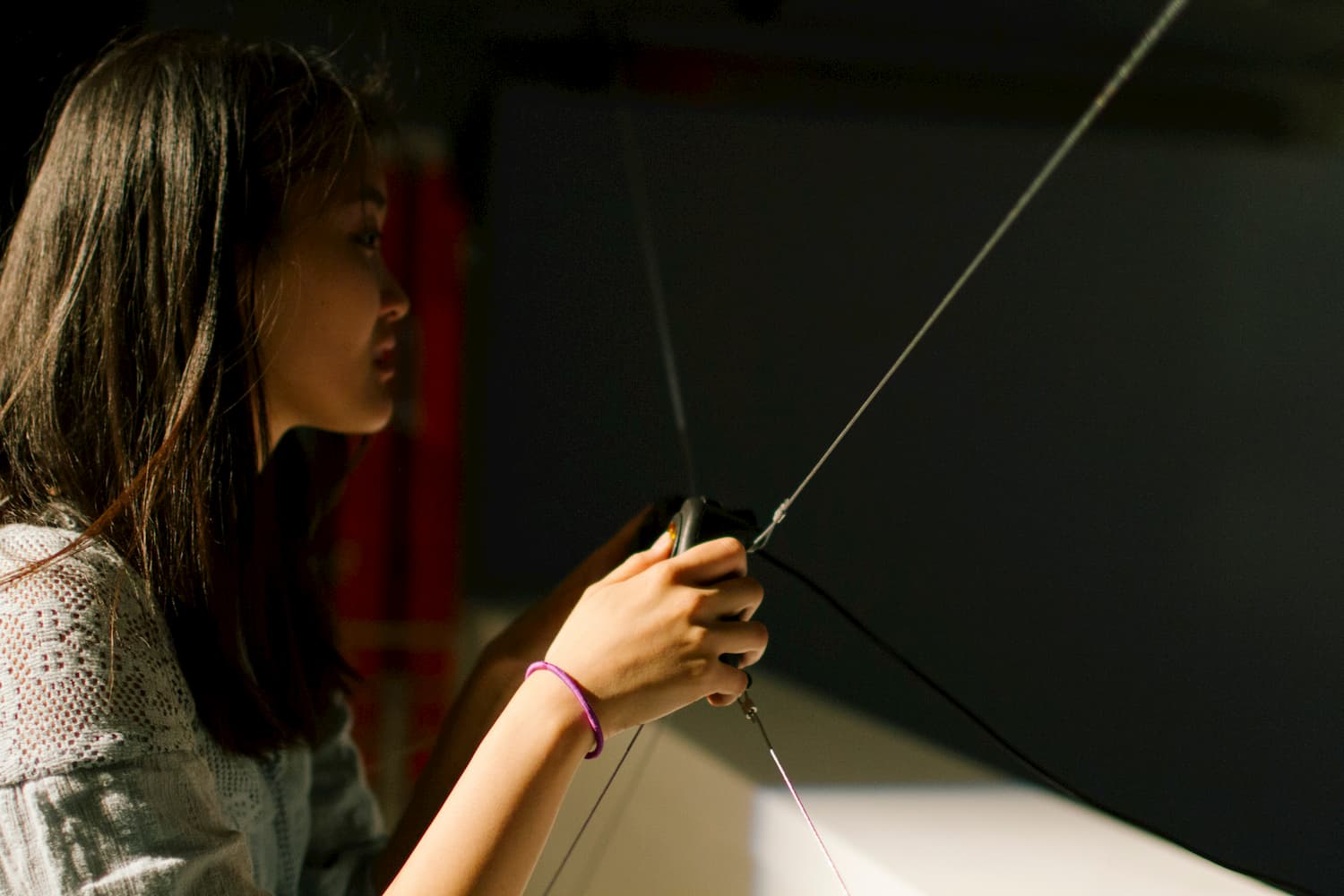Person holding a video game controller during YOUJIN CHUNG's solo show.