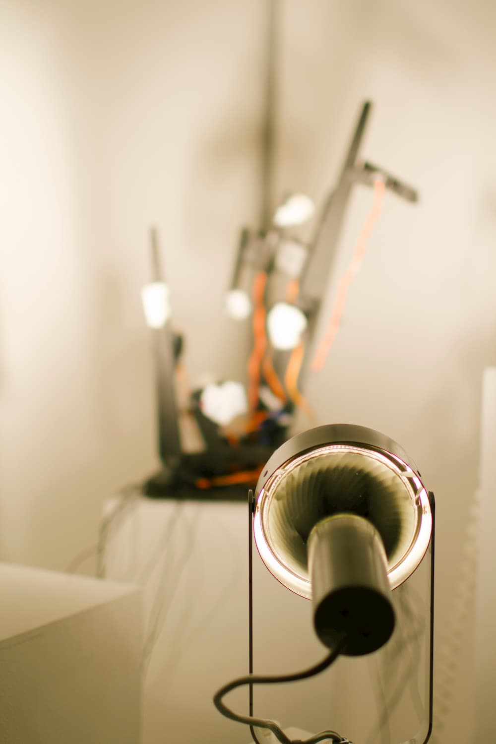 Lamp aimed at a sculpture during YOUJIN CHUNG's solo show.