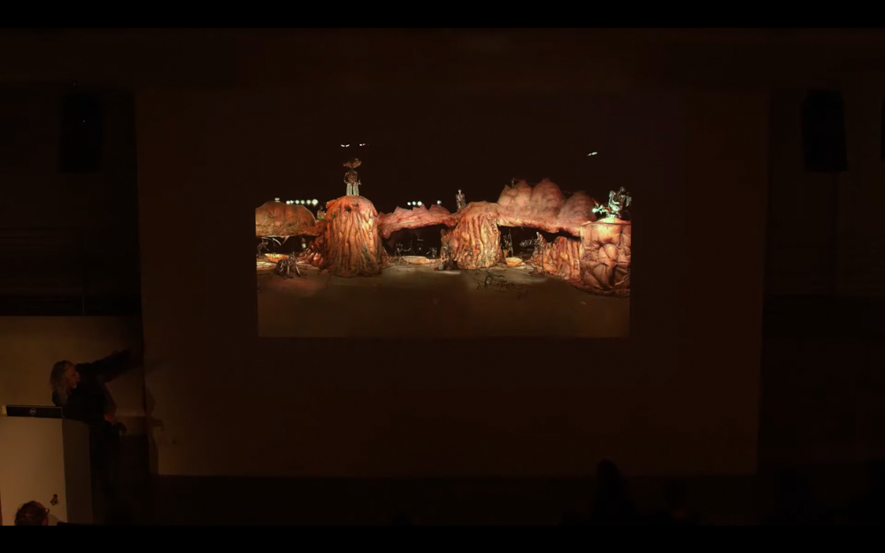 CHICO MACMURTRIE points to an image of his work projected on the walls of the EDA pit.