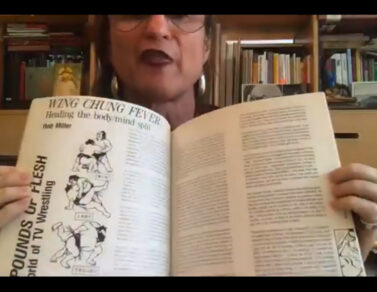 MCKENZIE WARK opens a book on their webcam to show the audience Wing Chung Fever.