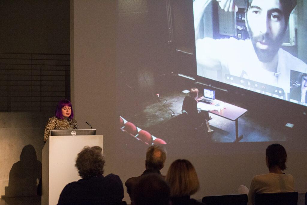 Angela Washko showing documentation of a webcam based performance.