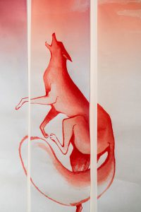 Art hung from the wall depicting an animal howling into the air.