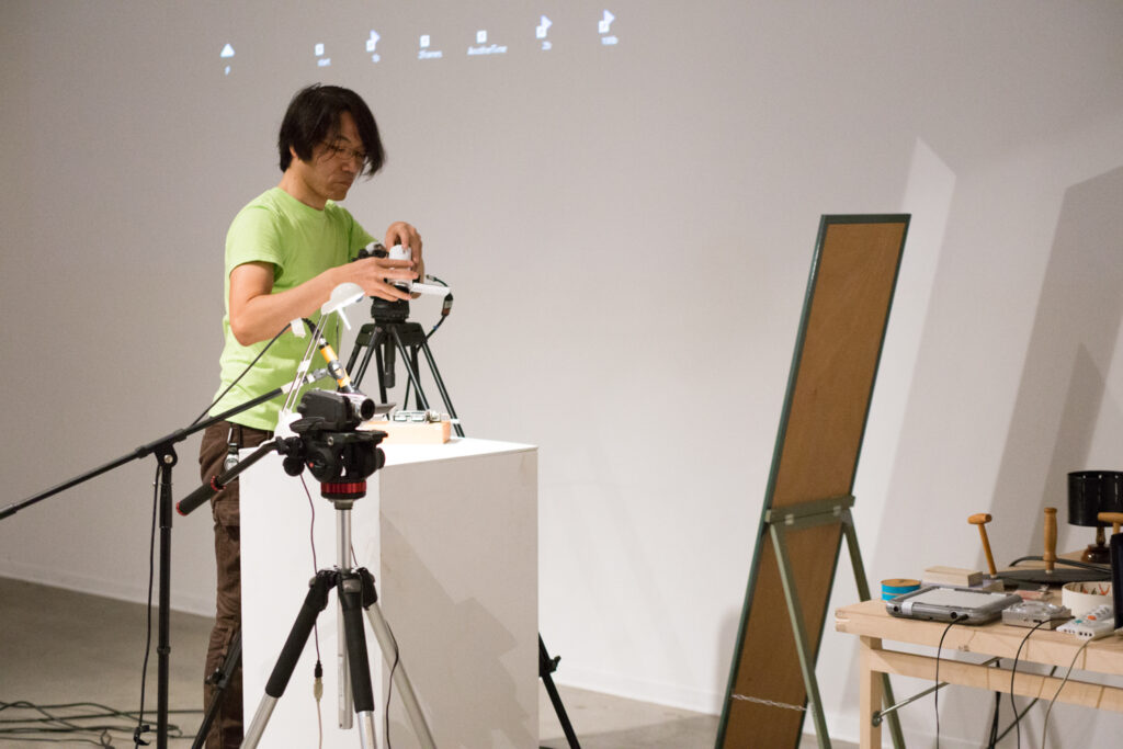 Toshio Iwai preparing for his lecture.
