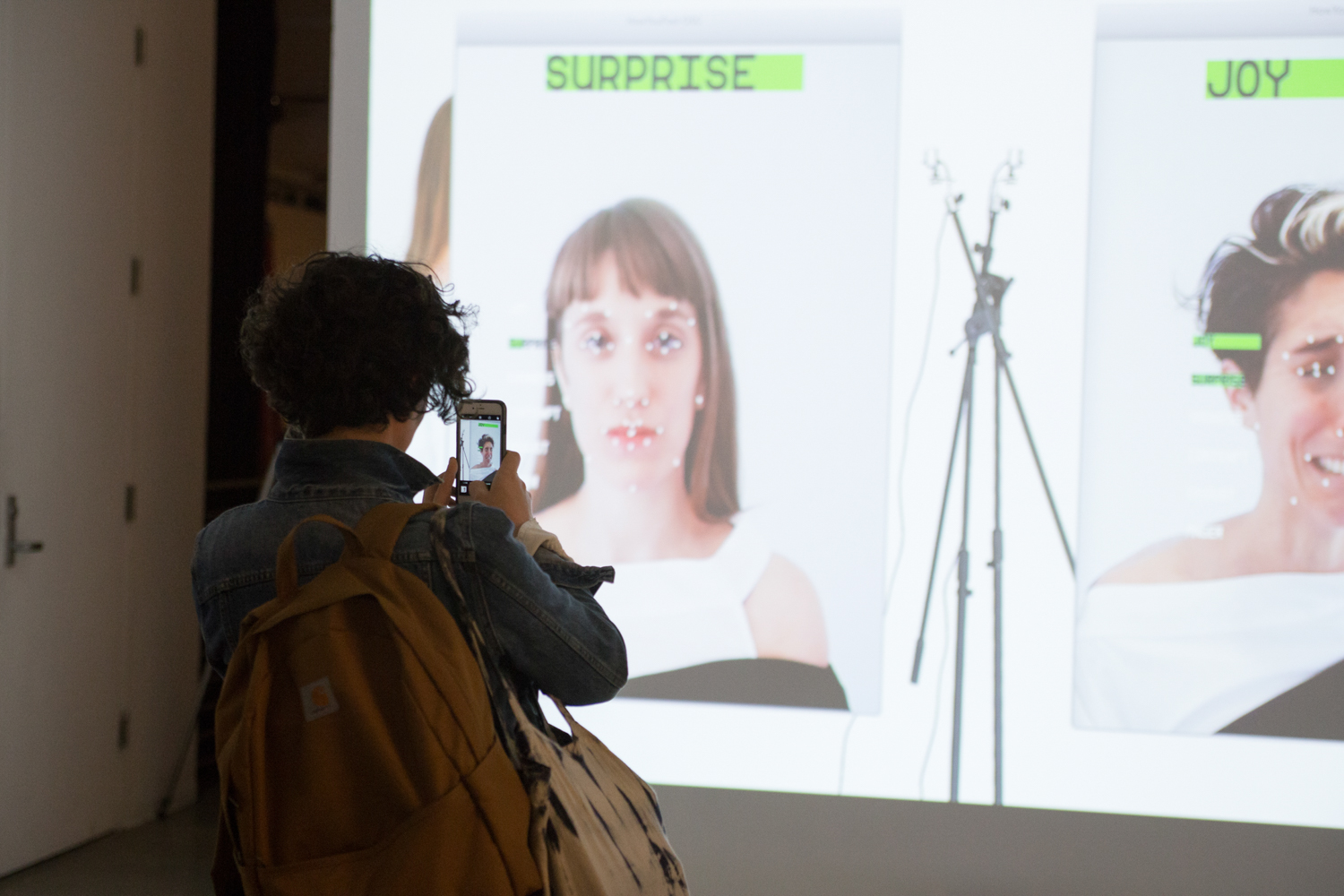 Real time face tracking with the words SUPRISE and JOY above the faces.