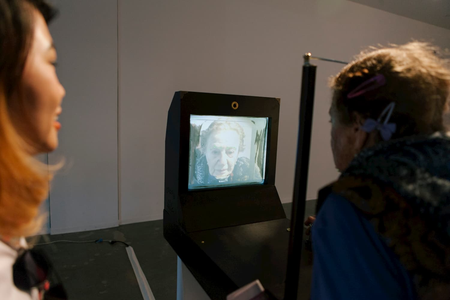 Person standing in front of of a camera and display which displays the person as older than they really are.