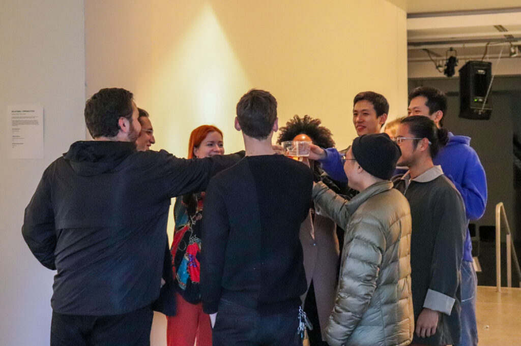 People give a toast to open Harvey Moon's solo show.