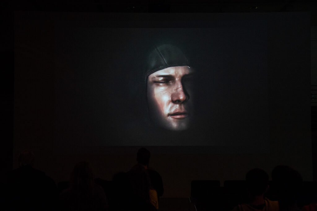 3d graphics of a head wearing a racing head sock.