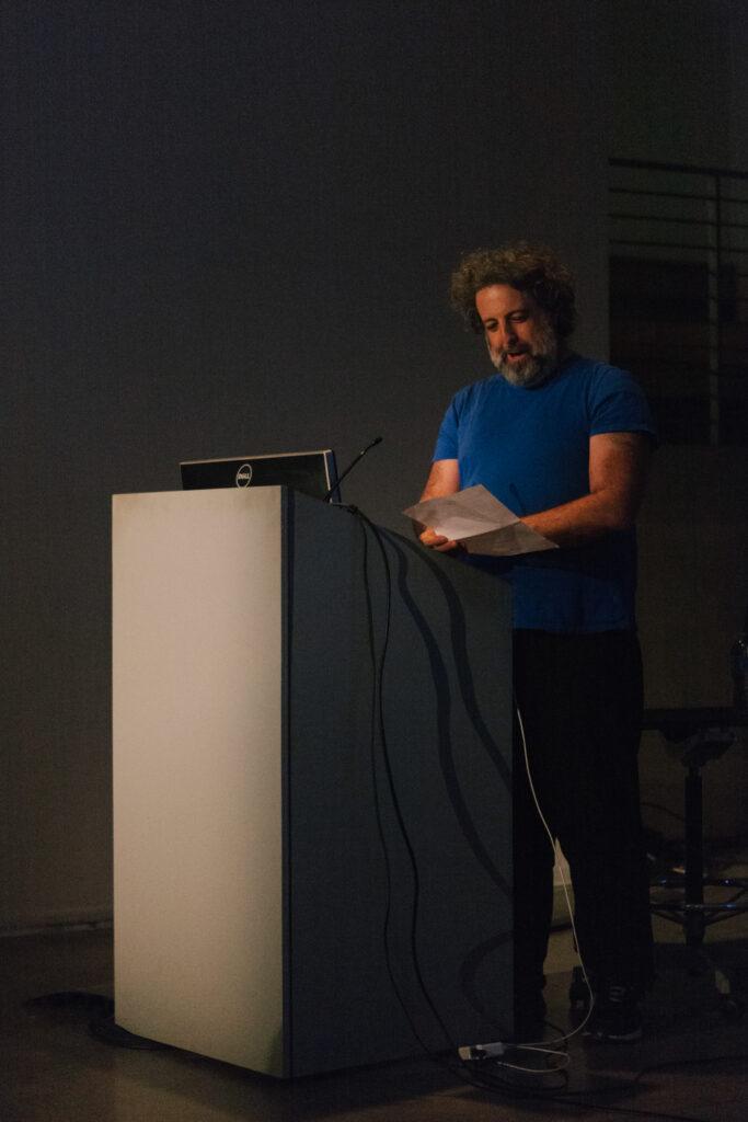 Eddo Stern introducing Daniel Landau to the pedestal.