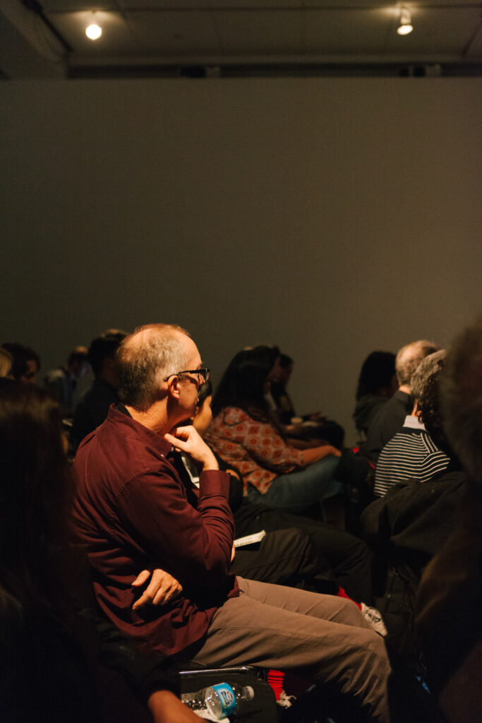 Audience member looking at Daniel Landau during Daniel's lecture.