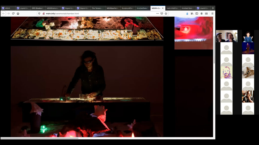 Photograph of Birch Cooper playing a live set with their music making machine.